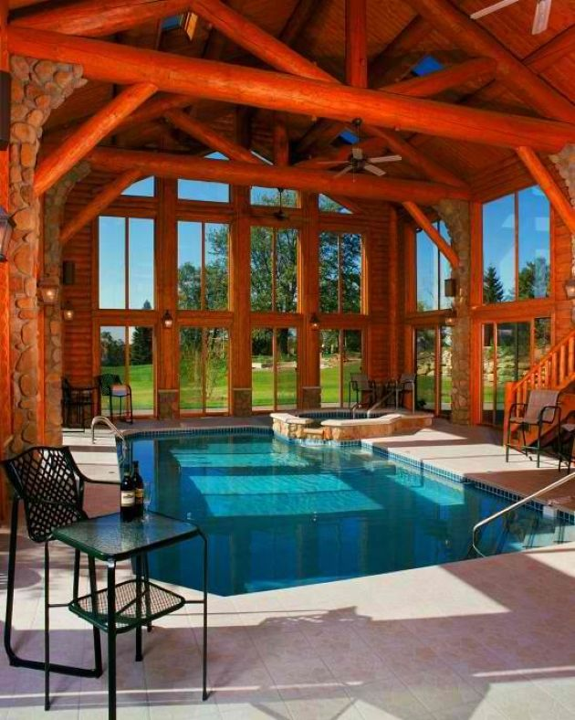Small Indoor Pool Inside A Cabin With Wooden Beams