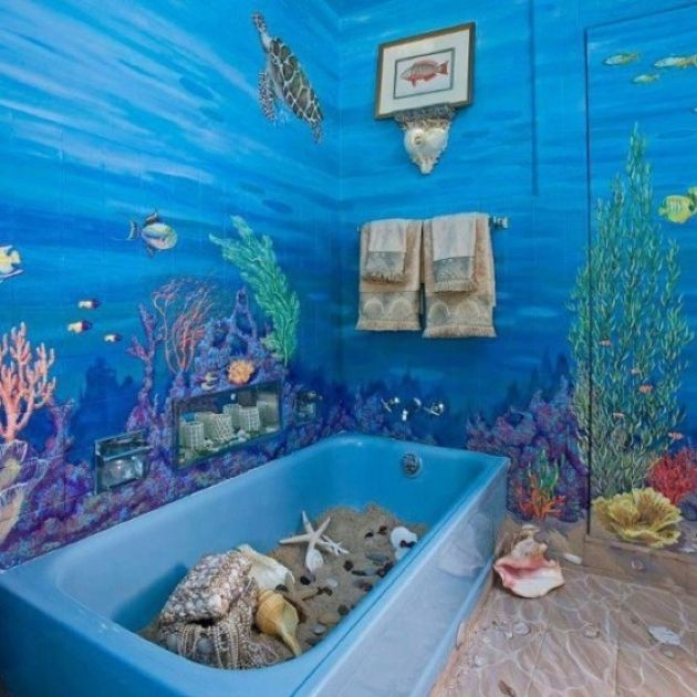 Super Bright Bathroom With A Blue Tub With Sand And Starfish Plus Seashells