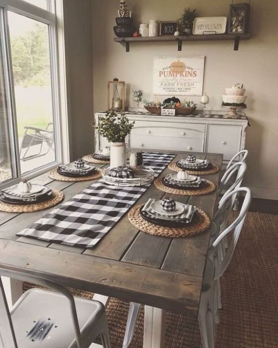 Traditional Farmhouse Dining Room With Checked Textiles And Wooden Table Plus Metal Chairs And A Buffet