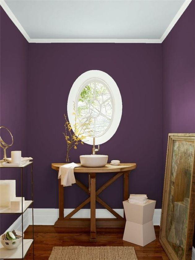 Unique Purple Bathroom With An Oval Framed Window