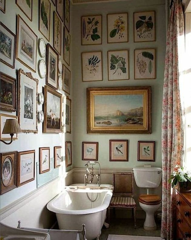 Wall Bathroom Decorating Idea With Artworks And Sconces