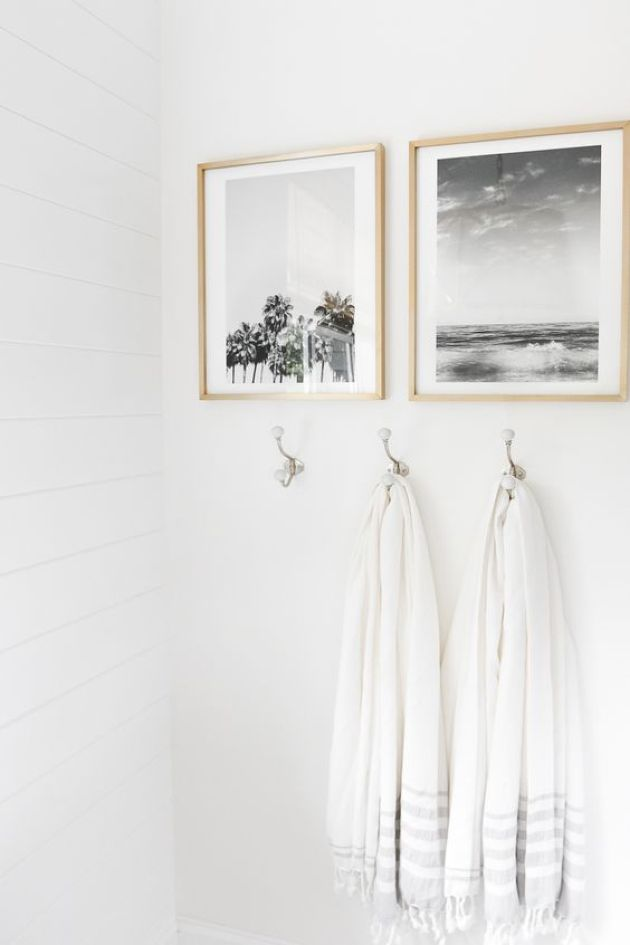 Wall Bathroom Decorating Idea With Personal Photos In Frames