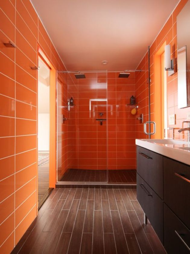 Warm Bathroom With Orange Tile Walls And Wood-Inspired Tiles
