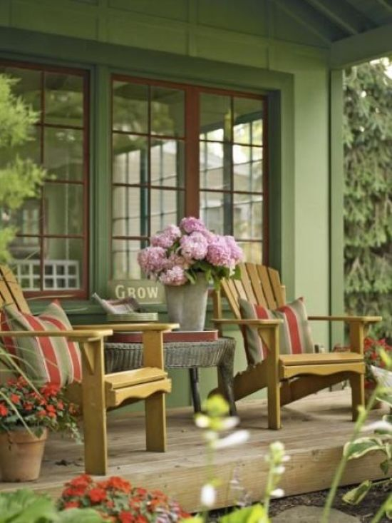 Welcoming Rustic Porch With Wooden Chairs And A Wicker Coffee Table