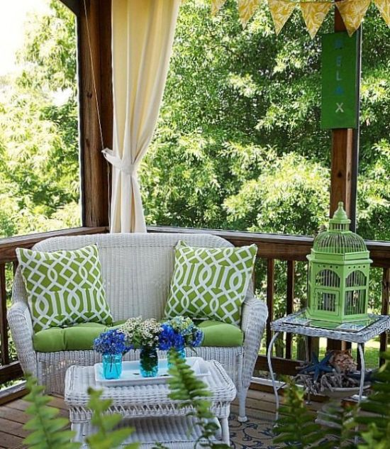 Welcoming Summer Porch With Green Signage And Lanterns