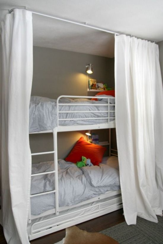 White Metal Kids Bunk Bed Unit With A Ladder Attached And Wall Sconces