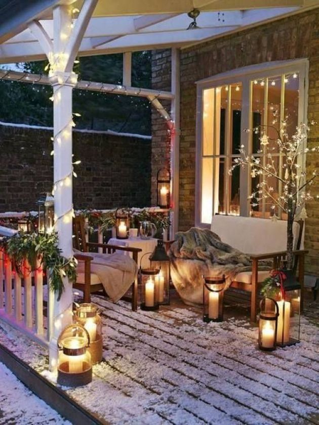 Winter Terrace Décor With Faux Fur Blankets And Candle Lanterns