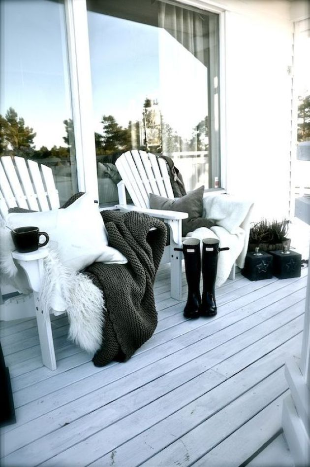 Winter Terrace Décor With Wooden Chairs With Pillows Plus Blankets And Faux Fur