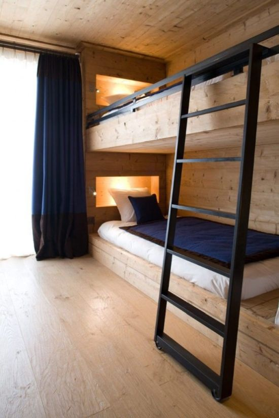 Wood Clad Bunk Bed Setup With Built-In Lights And With A Metal Ladder