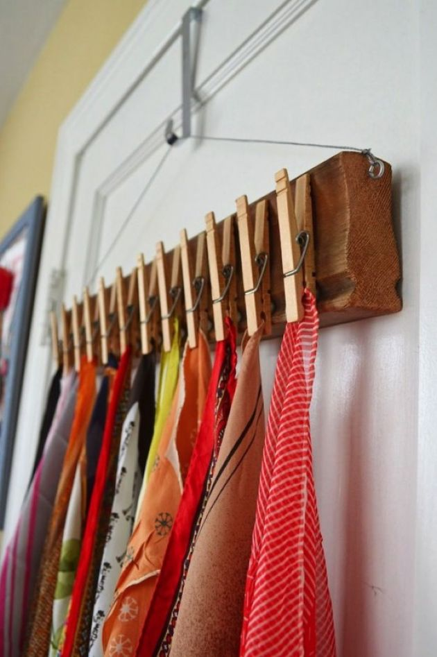 Wooden Shelf On A Clothes Hanger And Clothespins