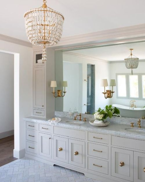 A Beautiful Brass And Mother-Of-Pearl Chandelier For Making A Statement In A Traditional Bathroom