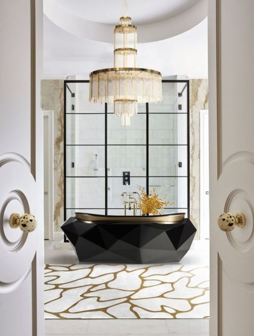 A Jaw-Dropping Bathtub With A Faceted Design And A Statement Chandelier Over It For A Bold Combo