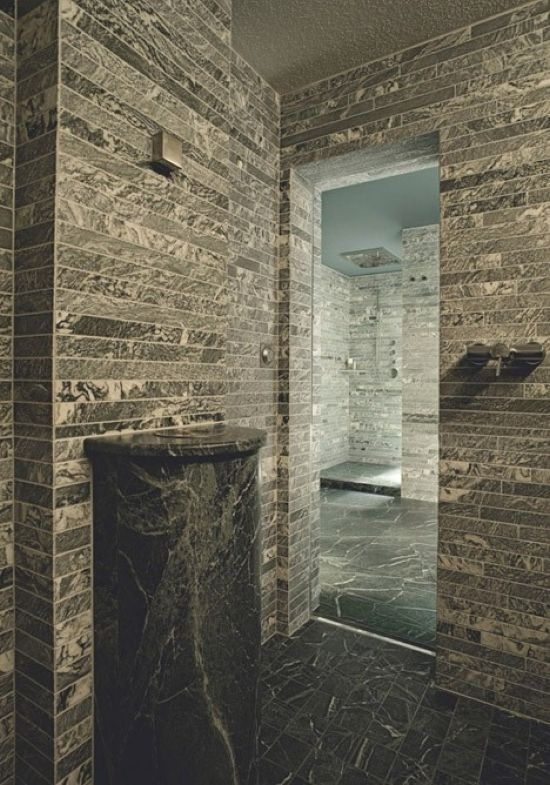 A Minimalist Bathroom Fully Clad With Tiles That Imitate Real Stone