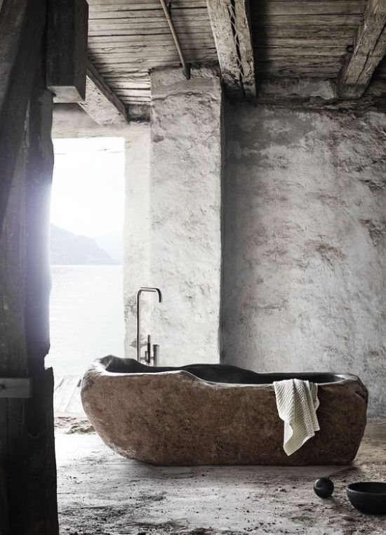 A Wabi-Sabi Bathroom With Plaster Walls And A Bathtub Cut Out Of A Stone Slab Is A Unique Idea