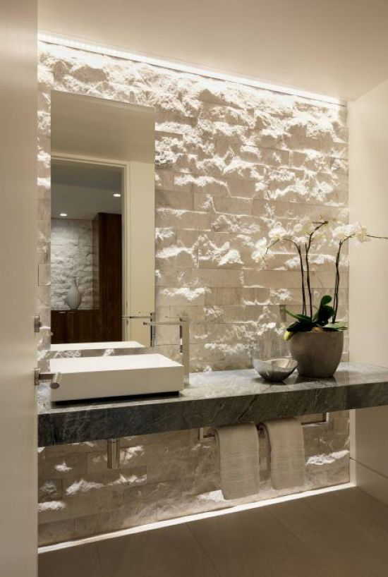 An Accent Wall Done With White Decorative Stone Is A Chic Idea For A Contemporary Space
