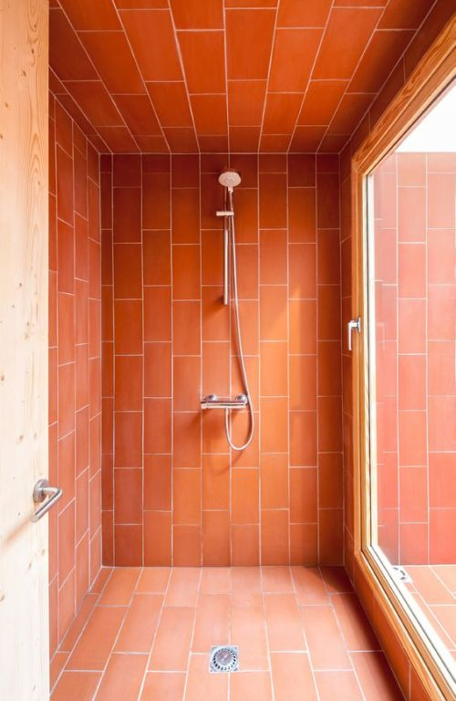 Bathroom With Shower Space Accented With Bright Coral Tiles