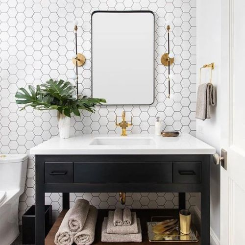 Bathroom With White Hex Tiles And Black Grout