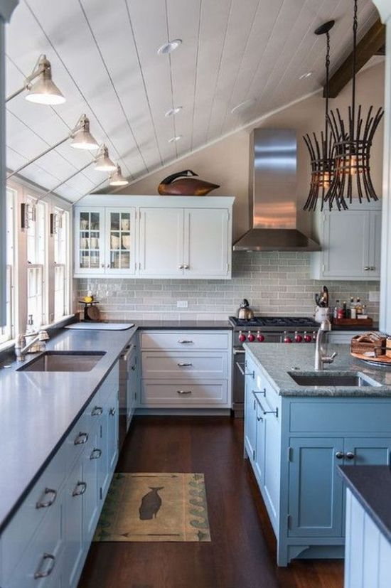 Beautiful Coastal Kitchen Featuring Wall And Ceiling Lights