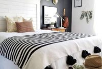 Black And White Boho Bedroom With A Black Statement Wall