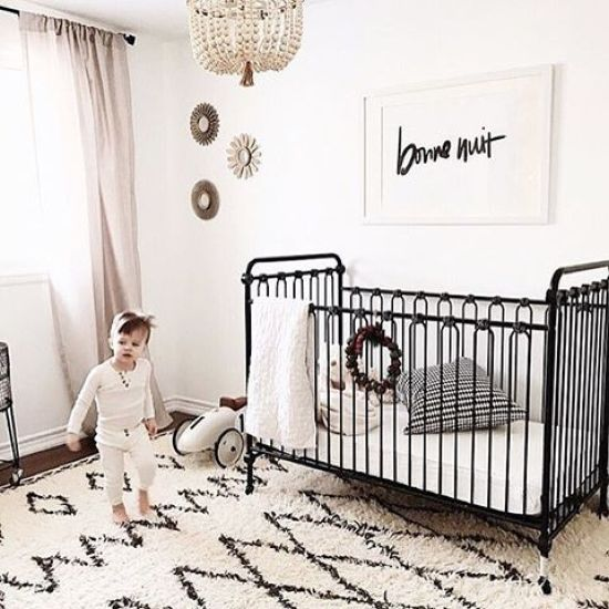 Black And White Nursery With A Printed Rug