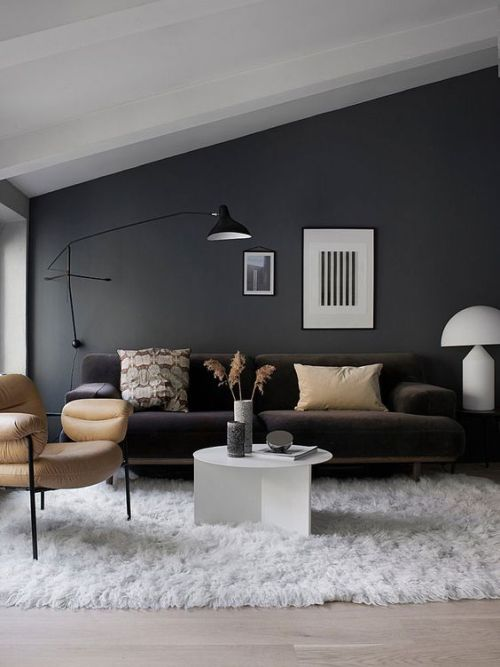 Black Wall Sconce Matching The Style And Colors Of This Living Room Providing Some Cozy Light