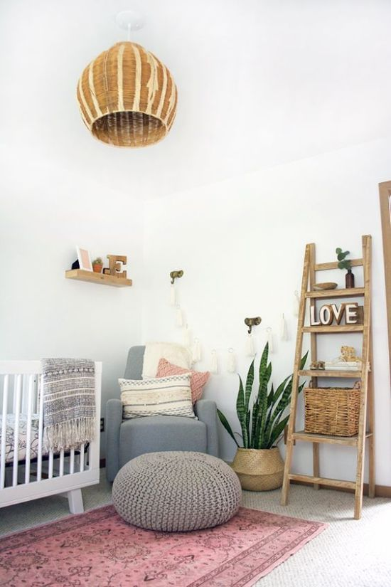 Boho Chic Nursery With A Pink Rug