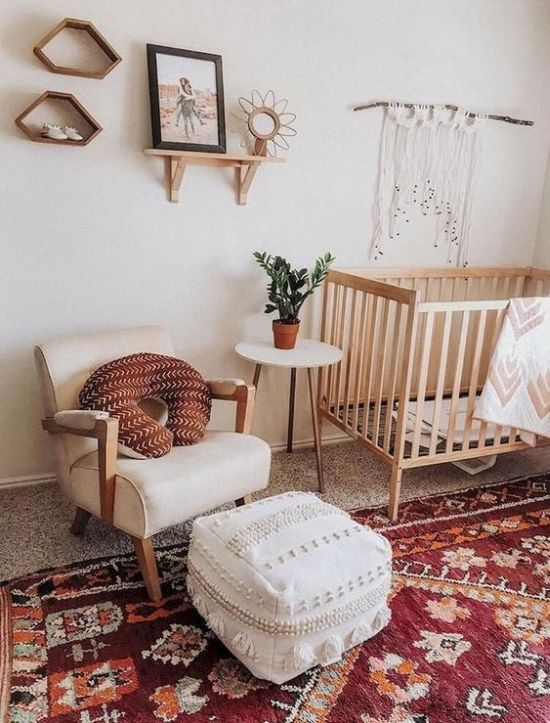 Bright Boho Nursery With A Red Boho Rug