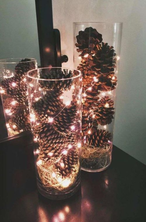 Centerpiece Idea For Fall And Thanksgiving With Clear Vases With Pinecones And Hay And Lights Will Fit Any Space