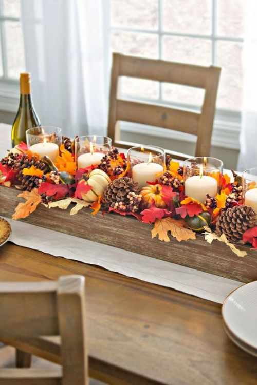 Centerpiece Idea For Fall And Thanksgiving With Fake Fall Leaves, Pinecones, Berries, Corn And Candles In Clear Candle Holders