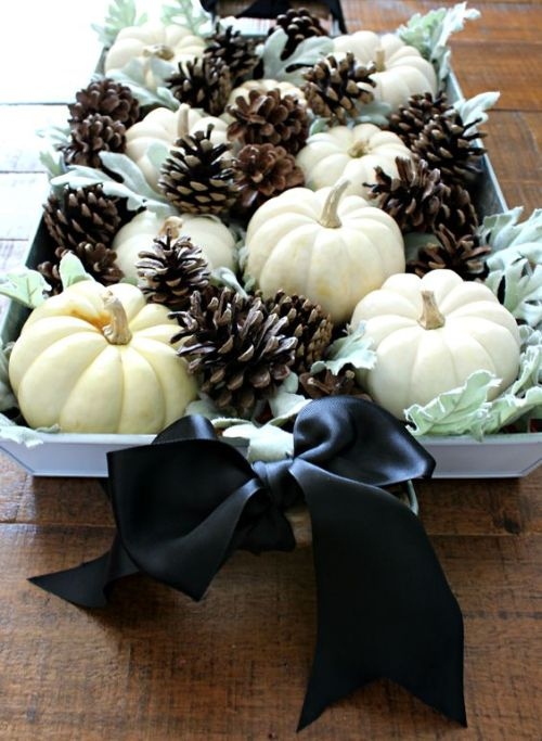 Centerpiece Idea For Fall And Thanksgiving With Pale Greenery And White Pumpkins Plus Pinecones And Black Silk Bows