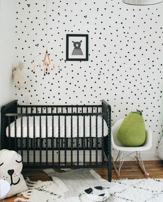 Chic Black And White Nursery With A Black Crib And Spotted Wall