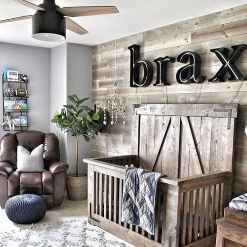 Cozy Farmhouse Nursery A Reclaimed Wood Wall And A Matching Crib A Name On The Wall A Leather Chair And A Lamp Fan