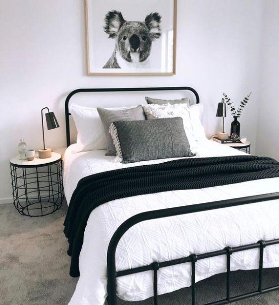 Cozy Small Bedroom In Black And White With A Black Metal Bed