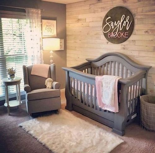 Cozy Small Farmhouse Space With A Reclaimed Wooden Wall A Grey Crib And Chair A Fluffy Rug And Shades On The Window
