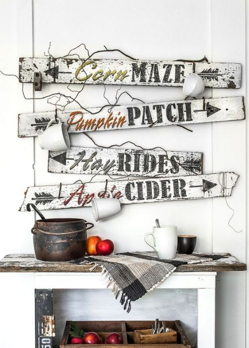 Creative And Unique Fall Sign To Welcome Autumn With A Bunch Of White And Black Fall Signs With Mugs Hanging On Them