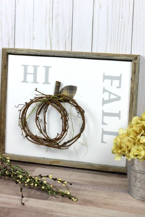 Creative And Unique Fall Sign To Welcome Autumn With A Non-Typical Fall Sign In A Reclaimed Wooden Frame Plus A Twig Pumpkin Attached And Yellow Blooms