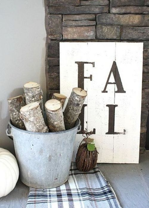 Creative And Unique Fall Sign To Welcome Autumn With A Very Simple Monochromatic Fall Sign And A Bucket With Cut Branches And A Plaid Blanket For Fall Decor