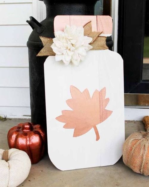 Creative And Unique Fall Sign To Welcome Autumn With A White Mason Jar With Leaf Fall Sign With A Burlap Ribbon And A Faux White Flower