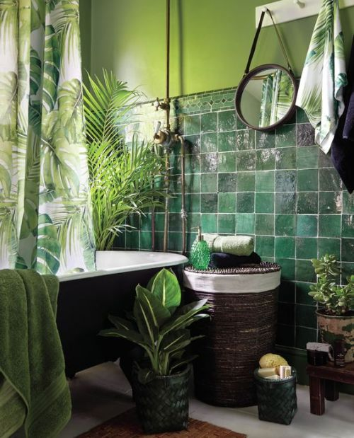Dark Green Tiles Paired With Light Green Wall And Lots Of Greenery And A Tropical Print Curtain For A Tropical Feel
