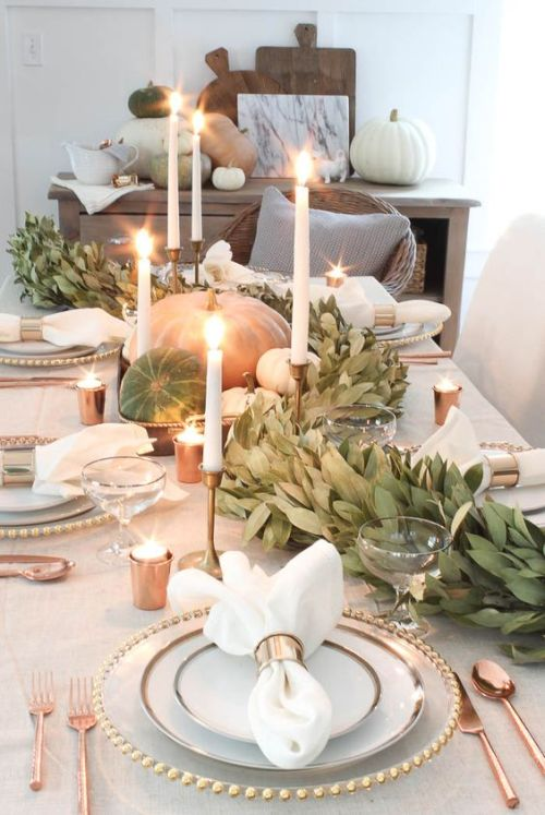 Fall Dining Room Decoration Idea With A Gorgeous Fall Table Runner Of Greenery And Natural Pumpkins And White Candles