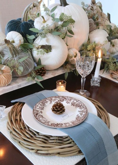 Fall Dining Room Decoration Idea With Natural And Fabric Pumpkins And Greenery And A Woven Placemat For A Fall Tablescape