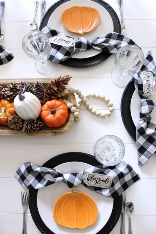 Fall Dining Room Decoration Idea With Plaid Napkins And Pumpkin Accents And A Centerpiece Of A Dough Bowl Plus Pinecones And Pumpkins And Beads