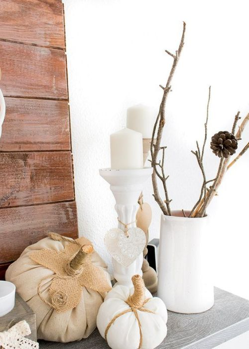 Fall Home Décor Idea With Branches In A White Vase And Some Faux White Pumpkins And Candles