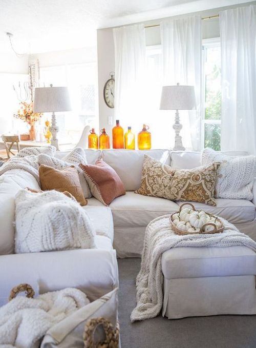 Fall Living Room Decoration Ideas With Amber Colored Bottles And A Basket With White Pumpkins