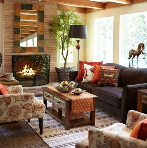 Fall Living Room Decoration Ideas With Bright Printed Pillows Plus A Printed Rug And A Bright Framed Mirror