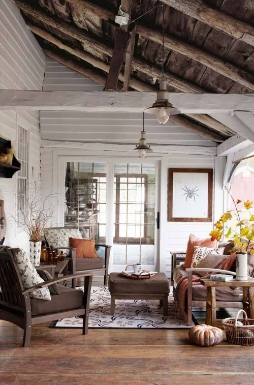 Fall Living Room Decoration Ideas With Rust-Colored Pillows And A Fall Leaf Arrangement