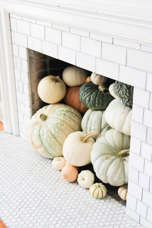 Home Decor Trend Ideas For Fall 2019 With A Non-Working Fireplace Fully Filled With Heirloom Pumpkins