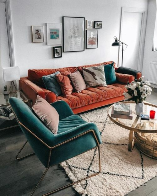 Home Decor Trend Ideas For Fall 2019 With A Rust-Colored Velvet Sofa With Muted And Teal Pillows Plus A Teal Velvet Chair