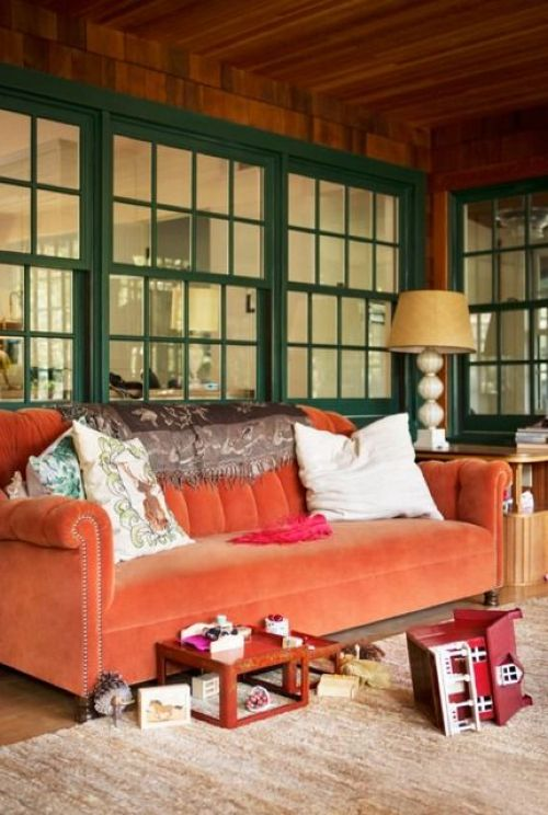 Home Decor Trend Ideas For Fall 2019 With An Orange Velvet Sofa Brings Traditional Fall Chic To This Screened Porch