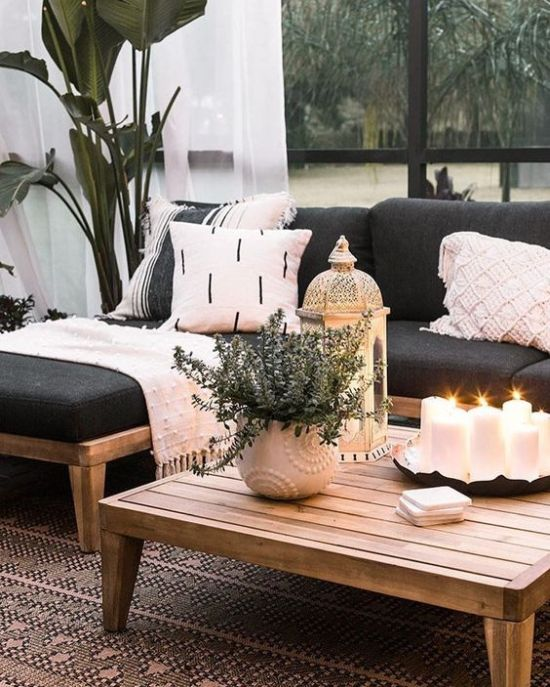 Low Wooden Coffee Table With An Arrangement Of Pillar Candles In A Tray